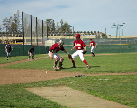 Freshman infiedler Marcus DiBenedetto (8) fields a bunt attempt by a Mission batter.